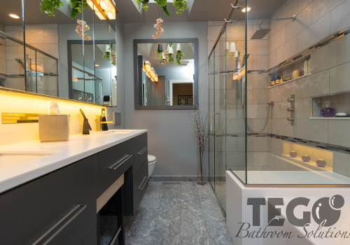 Soapstone floors and a framed mirror give this bathroom an endless feeling