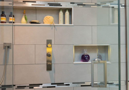 Rain, hand showers and water controls with plenty of shelf space in alcoves